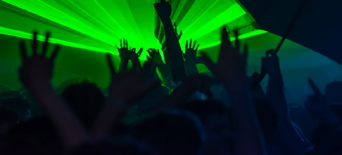 People dancing in a nightclub, a popular activity for young people in The Algarve.