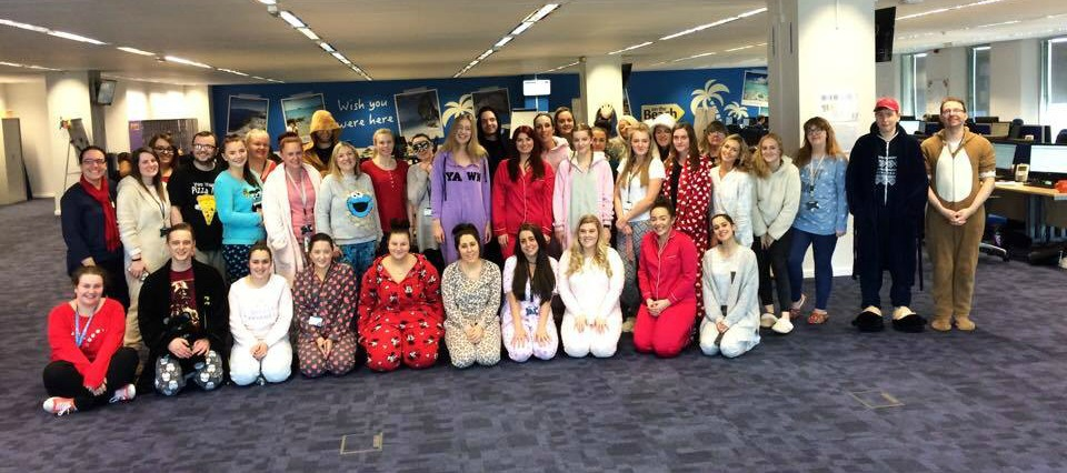 the team are wearing pyjamas for charity
